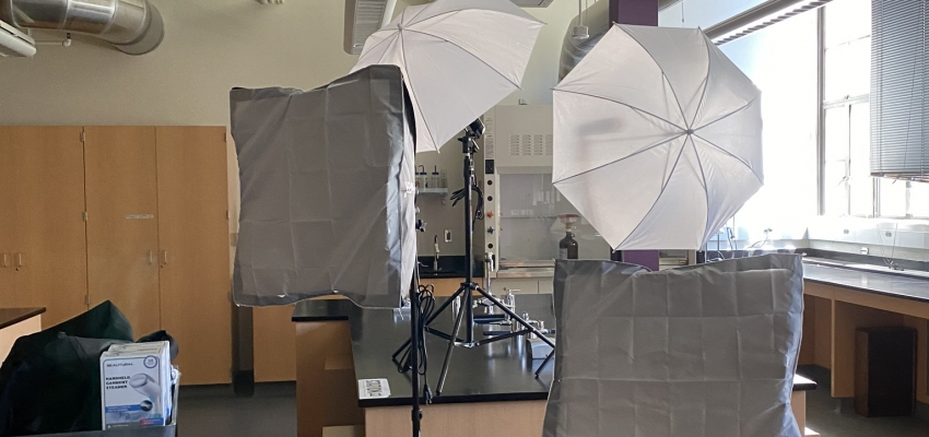 Lighting and backgrounds set up in an undergraduate teaching laboratory to shoot content for remote learning.