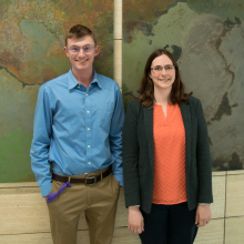 Undergraduate Researcher and Ashleigh Theberge standing in front of a painting in the HUB
