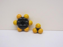 a yellow and black space-filling molecular model