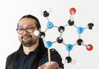 Jeffrey Buenaflor holding a molecular model