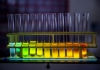 Stock photo of test tubes with fluorescent material in colors of blue, green, yellow, orange, and red