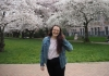 Rachel Huchmala in the Quad during the peak bloom of the cherry blossoms