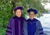 Ryan Shafranek poses in his UW PhD regalia with his mentor Prof. Al Nelson in Magnuson Park.