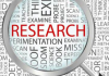 Research keywords and magnifying glass